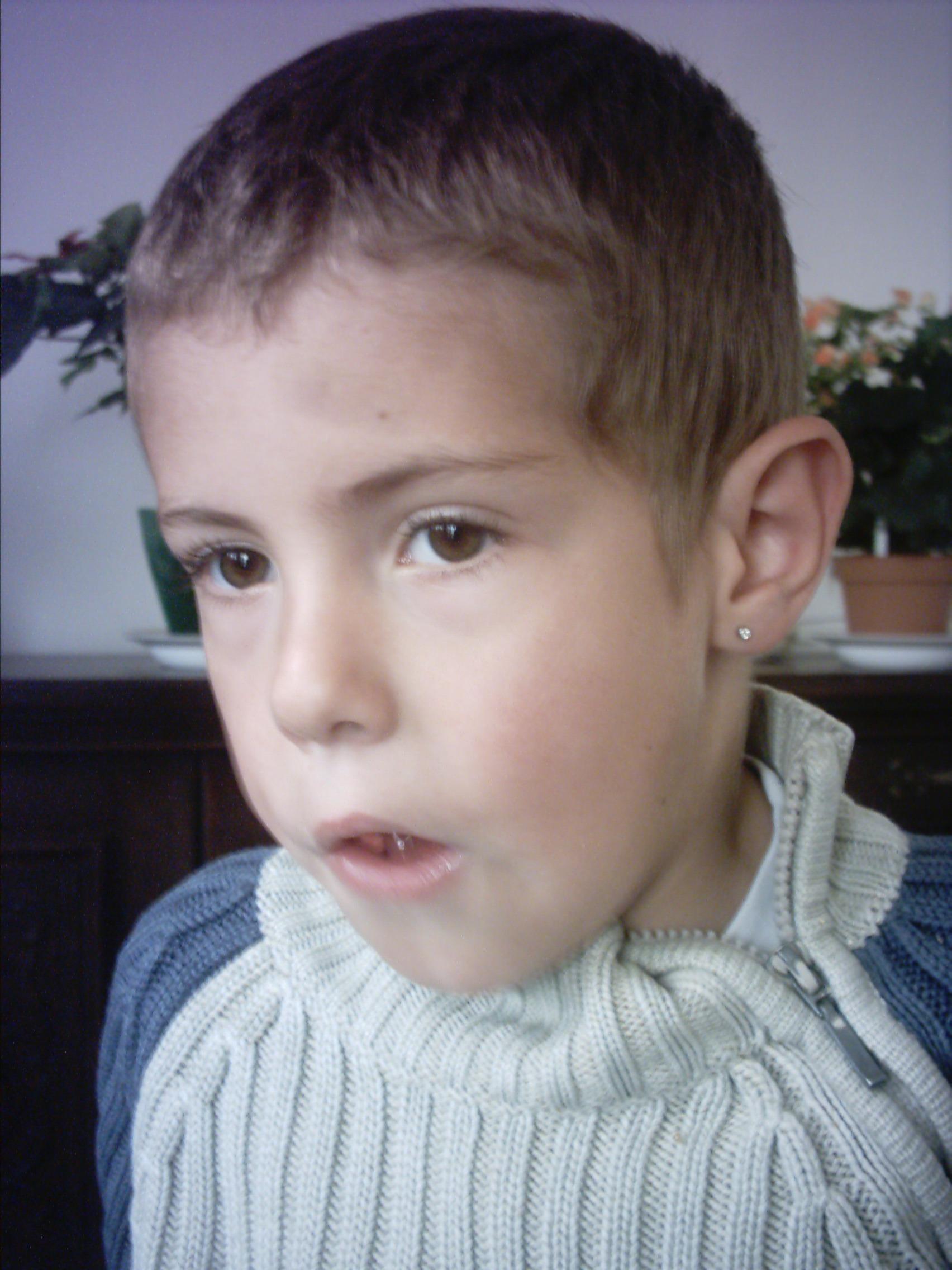 Boucle d'oreille jeune homme